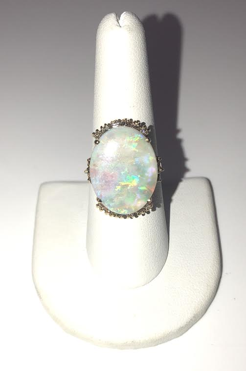 14k Yellow Gold Ring with a large Australian Opal center stone and diamonds! Original price: $2,600. Now on sale for $1999!